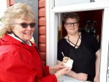 Carol Smith (L) of Richards Landing is served by proud new owner Ellen Barber (R)