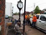 Guys from Littleton Electric connect power to clock as in kind donation from one of several local businesses.