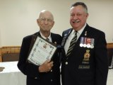 Comrade Harold Kent (L) accepts awards from Zone H4 Commander Sandy Ross (R).