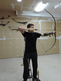 Cole Stevens shooting a recurve bow.