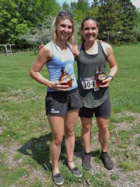 Women's 10Km winners collect their syrup.