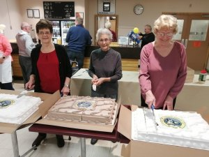 Ladies who were always active in the Island club were asked to cut the cake. Judy Wells (L), Mavis Chisholm (C) and Joyce Leask (R).