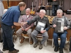 Voyageurs President Greg Gilbertson presents plaques to founding directors.