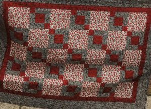 Community Quilters Donate Poppy Quilt