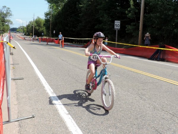 Abbie Wildman pedals her way to 3rd place in the Kids of Steel