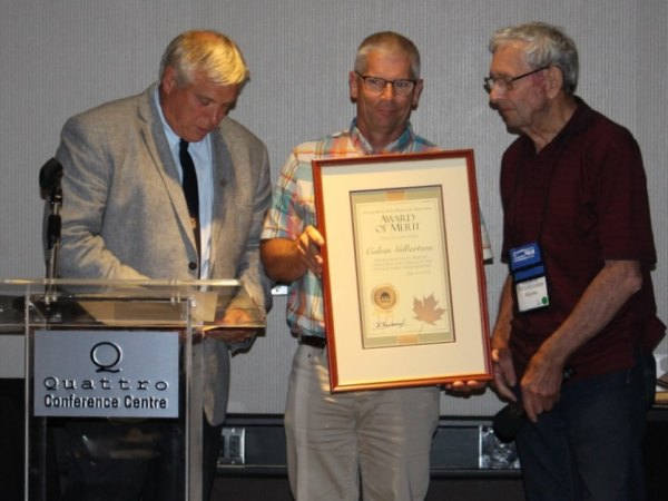 Award presented to Calvin Gilbertson (C) by Brian Bainborough, OMSPA President (L) & George Willoughby (R)