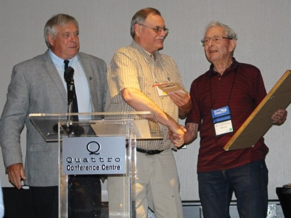 Award presented to Doug Thompson (C) by Brian Bainborough, OMSPA President (L) & George Willoughby (R)